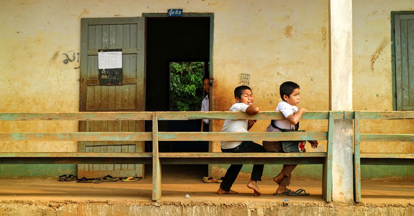 laos school students sitting outside